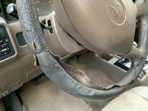 Sad looking Land Cruiser steering wheel ripped to shreds